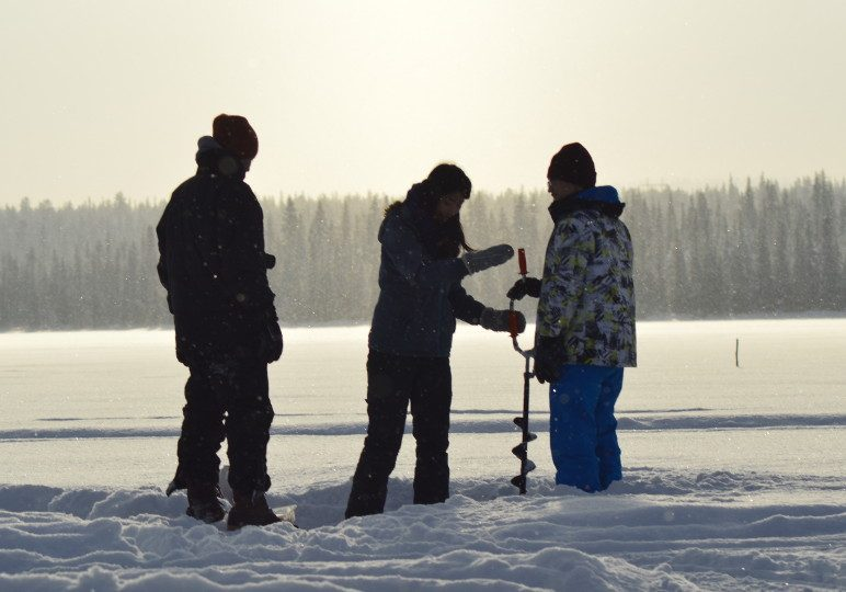 Ice fishing on our frozen Lake